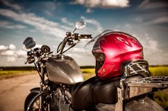 Motorcycle on the road. With a helmet on the handlebars stock photo