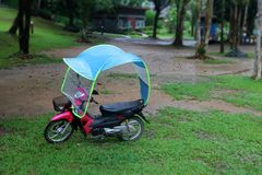 Motorcycle with a roof adapted to prevent rain Royalty Free Stock Photos