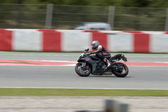 A motorcycle runs at Montmelo Circuit de Catalunya, a motorsport race track Stock Photo