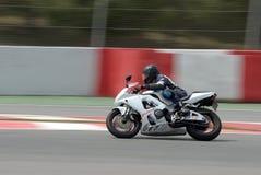 A motorcycle runs at Montmelo Circuit de Catalunya, a motorsport race track Stock Photos