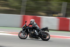 A motorcycle runs at Montmelo Circuit de Catalunya, a motorsport race track Royalty Free Stock Photography