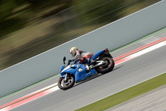 A motorcycle runs at Montmelo Circuit de Catalunya, a motorsport race track Royalty Free Stock Images