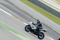 A motorcycle runs at Montmelo Circuit de Catalunya, a motorsport race track Stock Images