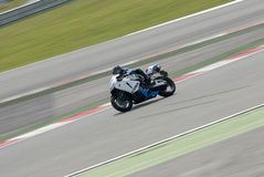 A motorcycle runs at Montmelo Circuit de Catalunya, a motorsport race track Royalty Free Stock Photo