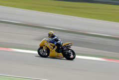 A motorcycle runs at Montmelo Circuit de Catalunya, a motorsport race track Stock Image