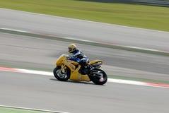 A motorcycle runs at Montmelo Circuit de Catalunya, a motorsport race track Stock Image