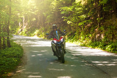 Motorcycle on the rural road. In Czech Republic Stock Photos