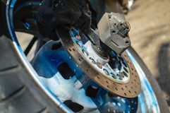 Motorcycle's back wheel and brake disc, closeup detail Royalty Free Stock Images
