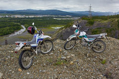 A motorcycle's Enduro on the brink of breakage, mountains. Susuman. Kolyma. IMG_2960. A motorcycle's Enduro on the brink of breakage, mountains. Susuman. The Royalty Free Stock Photo