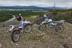A motorcycle's Enduro on the brink of breakage, mountains. Susuman. Kolyma. IMG_2960 Royalty Free Stock Photo