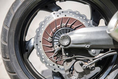 Motorcycle's front wheel and brake disc Stock Photos