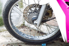 Motorcycle's wheel. Motorcycle's front wheel with tire Royalty Free Stock Image