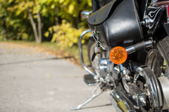 Motorcycle saddlebags. And turn signal in focus. Nature background Royalty Free Stock Photo