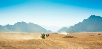 Motorcycle safari Egypt. Motorcycle safari in the land Egypt. People travel. Beautiful  holiday background. Extreme hobby games.  Speed achievement tracking Stock Photography