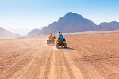 Motorcycle safari Egypt. Motorcycle safari in the land Egypt. People travel. Beautiful  holiday background. Extreme hobby games.  Speed achievement tracking Royalty Free Stock Photos