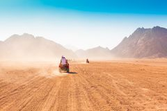Motorcycle safari Egypt!. Motorcycle safari in the land Egypt. People travel. Beautiful  holiday background. Extreme hobby games.  Speed achievement tracking Royalty Free Stock Images