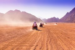 Motorcycle safari Egypt!. Motorcycle safari in the land Egypt. People travel. Beautiful  holiday background. Extreme hobby games.  Speed achievement tracking Royalty Free Stock Photos