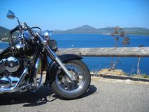 Motorcycle by the sea Stock Photos