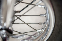 Motorcycle Wheel Spokes. Motorcycle shiny chrome wheel spokes close-up Stock Images