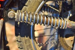 Motorcycle shock absorber close up, spring mechanism royalty free stock photos