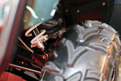 Motorcycle shock absorber. Focus on motorcycle shock absorber and wheel tyre; note shallow depth of field Stock Photo