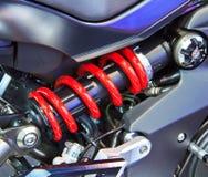 Motorcycle shock Stock Photos