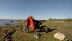 Motorcycle on the shore of the Rybinsk Reservoir stock video footage