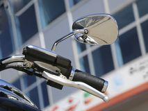 Motorcycle side mirror. handle and rear view mirror of motorcycle. Royalty Free Stock Photos
