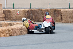 Motorcycle Sidecar race in Ostend Belgium. The assistant is shaving the hay bales in a left turn Royalty Free Stock Photos