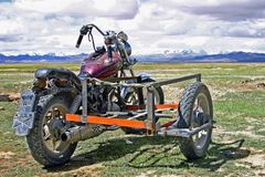 Motorcycle with sidecar used by Tibetan nomad. Motorcycles are replacing horses, for the Tibetan nomads. Shown here is a typical motorcycle suited to the rugged Stock Photography