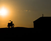 Motorcycle silhouette against the sunset Royalty Free Stock Images