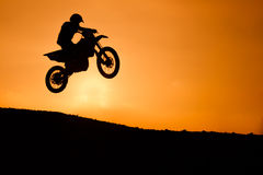 Motorcycle silhouette are jumping Stock Photo