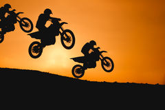 Motorcycle silhouette are jumping Royalty Free Stock Photos