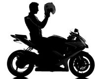 Motorcycle. Silhouette of a motorcycle racer with helmet on the white background stock photos