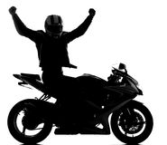 Motorcycle. Silhouette of a motorcycle racer on the white background with his hands up royalty free stock images