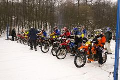 Motorcycle skijoring racers prepare for ride. KLASTEREC NAD ORLICI, CZECH REPUBLIC - JANUARY 29: Motorcycle skijoring racers prepare for ride on January 29, 2017 Royalty Free Stock Images