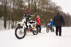 Motorcycle skijoring racers prepare for ride. KLASTEREC NAD ORLICI, CZECH REPUBLIC - JANUARY 29: Motorcycle skijoring racers prepare for ride on January 29, 2017 Royalty Free Stock Photography