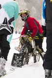 Motorcycle skijoring racers prepare for ride. KLASTEREC NAD ORLICI, CZECH REPUBLIC - JANUARY 29: Motorcycle skijoring racers prepare for ride on January 29, 2017 Stock Image