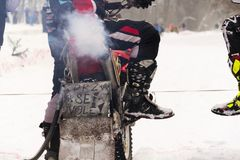 Motorcycle skijoring racers prepare for ride. KLASTEREC NAD ORLICI, CZECH REPUBLIC - JANUARY 29: Motorcycle skijoring racers prepare for ride on January 29, 2017 Stock Images