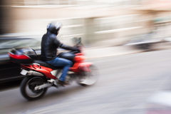 Motorcycle speed. Motorcycle in the city in motion blur Stock Photography