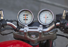 Motorcycle speedo. The speedometer of an old bike with miles Royalty Free Stock Image