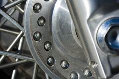 Motorcycle Spokes. Aluminum spokes and rotor on a motorcycle Royalty Free Stock Image