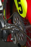 Motorcycle Sprocket and Chain. Detail of the rear wheel with sprocket and chain connected on a motocross or offroad motorcycle Stock Photography