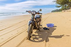 The motorcycle stands on the beach. Vietnam. South China Sea Stock Photo