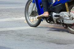 Motorcycle stop at white line on junction waiting for traffic li Stock Photography