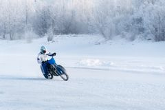 Motorcycle on studded tires. Extreme bike race in winter. motorcycle on the ice of the frozen Lake Baikal. Racer on ice. Motorcycle with studded tires driving stock photography
