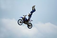 Motorcycle stunt acrobatics Royalty Free Stock Photo