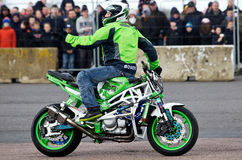 Motorcycle stunt rider. PODINGTON, UK - FEBRUARY 22: Stunt rider Lee Bowers stands on his specially modified motorcycle while demonstrating his stunt show at the Stock Photography