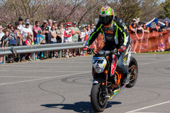 Motorcycle Stunt Rider - Stoppie. VICTORIA/AUSTRALIA - SEPTEMBER 2015: Stunt motorcycle rider performing at a local car show on the 13 September 2015 in Corowa Royalty Free Stock Photography