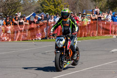 Motorcycle Stunt Rider. VICTORIA/AUSTRALIA - SEPTEMBER 2015: Stunt motorcycle rider performing at a local car show on the 13 September 2015 in Corowa Royalty Free Stock Photography